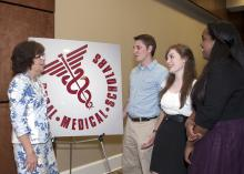 The Rural Medical Scholars program at Mississippi State University is designed to address the state's shortage of medical professionals. From left are Extension Service rural health program leader Bonnie Carew and three of the high school seniors who participated this year: Jason Carter of Horn Lake, Elizabeth Tedford of Clarksdale and Sabrina Micha of Starkville. (Photo by MSU Ag Communications/Kat Lawrence)