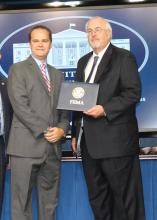 Ryan Akers, an assistant Extension professor in the Mississippi State University School of Human Sciences, left, receives Champions of Change recognition from Federal Emergency Management Agency administrator Craig Fugate at recent ceremonies in Washington, D.C. Additionally, the Mississippi Youth Preparedness Initiative, which is coordinated by Akers, won the national FEMA Individual and Community Preparedness Award for Most Outstanding Youth Preparedness program. (Submitted photo)