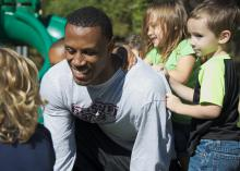 Matt Wells, a senior football player at Mississippi State University, interacts with preschool children during his internship at the MSU Child Development and Family Studies Center. (Photo by MSU College of Agriculture and Life Sciences/David Ammon)