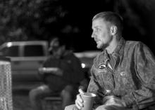 Jack Walker of Hattiesburg sits by the campfire on Dec. 12, 2014 at the Hot Coffee Hunts for Heroes held for wounded veterans. (Photo by Robert Lewis)