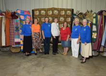 Quilters from the Mississippi Homemaker Volunteers of Covington County, from left,Carolyn Williamson, Martha Douglas, Wanda Hall, Doris Sullivan, Connita Weber, Mary Sokovich and Jo Bucklew, spent months creating quilts for wounded veterans who arrived for the Hot Coffee Hunts for Heroes on Dec. 12, 2014. (Photo by MSU Ag Communications/Kevin Hudson)