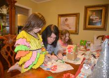 Adrienne Mercer (center) of Louisville, Mississippi, assists her daughter, Millie Kate, in a salt-dough ornament project on Dec. 13, 2014. Family friend Anna Claire Quinn also enjoyed doing fun projects that can build important learning skills and relationships. (Submitted Photo)