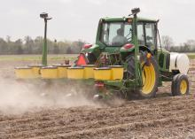 A Mississippi State University worker at the Northeast Mississippi Branch Experiment Station in Verona takes advantage of the ideal weather for corn planting on April 7. (Photo by Scott Corey)
