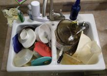 Leaving dirty dishes in the sink provides a feast for pests. Integrated pest management emphasizes practical, cost-efficient strategies for keeping rodents and insects out of the home. (Photo by MSU Extension Service/Kevin Hudson)
