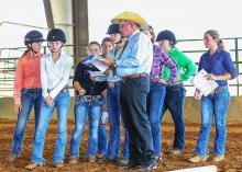 Tom McBeath of Union, Mississippi, explains a riding pattern he will judge to a group of young women. McBeath, a long-time volunteer with the Mississippi 4-H Program, is the American Youth Horse Council Adult Leader of the Year. (Photo by Jeff Homan)