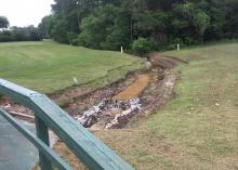 A Mississippi State University associate professor of landscape architecture, working with the Mississippi Water Resources Research Institute, designed this dry swale to reduce nonpoint-source pollution from runoff at a south Mississippi golf course. (Photo by MSU Extension Service/Beth Baker).