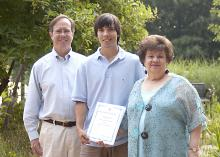 Andrew Shaman, center, a senior majoring in forestry at Mississippi State University, received a $3,500 scholarship from the National Garden Clubs. The award was presented by Ann Chiles, scholarship chairwoman for the Garden Clubs of Mississippi, and Ian Munn, dean of MSU's College of Forest Resources. Shaman is the son of Chris and Felicia Shaman and a resident of Brandon. (Photo by MSU College of Forest Resources/Karen Brasher)