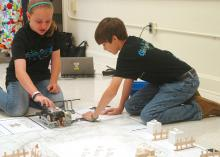 Lillian Stewart and Thaddeus Webb, members of The Mean Machines 4-H robotics team in Rankin County, practice with their robot before afternoon competition at the Southwest District 4-H Project Achievement Day held at Hinds Community College in Raymond, Mississippi. Junior 4-H members, ages 8 to 13, participated in contests on a variety of topics, including foods and nutrition, engineering, and meat and dairy judging on June 6, 7, 12 and 13. (Photo by MSU Ag Communications/Susan Collins-Smith)