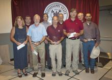 Regions Bank representatives joined Mississippi State University Division of Agriculture, Forestry and Veterinary Medicine administrators and faculty to recognize the winners of the 2014 Regions Bank-DAFVM, MSU Superior Faculty Awards on July 25, 2014. Back row, from left: Walt Stephens, Regions Greenville City president; Gregory Bohach, DAFVM vice president; Samuel W. Slaughter III, Regions Starkville City president; and George Jarman, Regions Delta City president. Front row, from left: Service Award winne