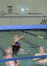 Walking, tai chi, weight-bearing exercises and water workouts, such as water volleyball, will improve strength, balance, coordination and flexibility. (Photo by MSU Ag Communications/Kevin Hudson)