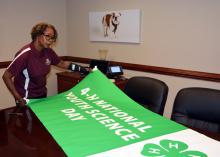 Paula Threadgill, associate director of the Mississippi State University Extension Service and state leader of 4-H, reviews a poster that will hang in the 4-H Village in the Trademart in Jackson during the Mississippi State Fair from Oct. 7-18. The photo was taken at MSU on Oct. 2, 2015. (Photo by MSU Ag Communications/Linda Breazeale)