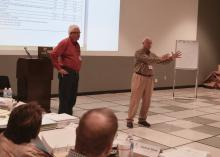 Hancock County tax assessor Jimmie Ladner Jr., left, and Mississippi Assessors and Collectors Association executive director Joel Yelverton brief newly elected tax assessors during a training held at the Mississippi State University Bost Extension Center Nov. 18, 2015. (Photo by Bob Ratliff, MSU Extension)
