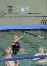 Adults enjoy a friendly game of water volleyball as they aim for at least 150 minutes of moderate exercise each week. (MSU Extension Service file photo/Kevin Hudson)