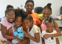 Campers (front row, from left) Jendiya Harkins, Jayda Robson, Ankeria Harkins and Morgan Peterson; and Travis Jones and Ceniyah Jamison learn robotics at a community summer camp on July 11, 2016 in Artesia, Miss. The Mississippi State University Extension Service and 4-H uses robotics to introduce children to science, technology, engineering and mathematics programs at an early age. (Photo by MSU Extension Service/Michaela Parker)
