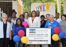 Members of Mississippi State University Extension Service, the Early Years Network and Excel by 5 celebrated the grand opening of the North Central Mississippi Resource and Referral Center with Durant Mayor Tasha Davis (center) and community members on Aug. 2, 2016. The center provides early child care educators, families and other residents in Holmes County a place to visit and borrow educational books, toys and games. (Photo by MSU Extension Service/Alexandra Woolbright)