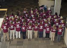 """The Mississippi State University College of Veterinary Medicine's Class of 2016 rings out the rabies prevention message with the tag line, """"Less Rabies, More Cowbell."""" The class performed several outreach and education projects and won the honor of hosting the annual Merial Rabies Symposium. (Photo by College of Veterinary Medicine/Tom Thompson)"""