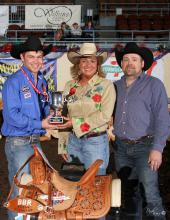 Bricklee Miller, manager of the Mississippi Horse Park at Mississippi State University, receives the Better Barrel Racing Association's Producer of the Year trophy from Garrett Yerigan, left, and Destry Fleming at the barrel racing finals in Oklahoma City on April 26, 2014. (Submitted Photo)