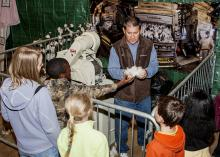 Mississippi State University Extension Service regional agronomic crops specialist Dennis Reginelli shows students cotton at the FARMtastic Mighty Crops station on Nov. 11, 2013. The third annual FARMtastic will take place this year from 9 a.m. until 1 p.m. Nov. 10-15 at the Mississippi Horse Park near Starkville. (File photo by MSU Ag Communications/Scott Corey)