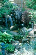 Active water is different in that it moves, such as a cascading, rocky waterfall or a babbling brook. Active water features open up a new sensory perception -- sound.