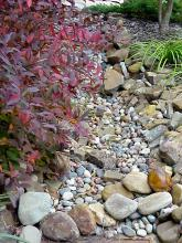 A dry creek bed can flow as needed and is one of the hottest trends in Mississipp.