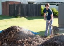Ted Benge, a landscape architecture student from Nashville, turns a steaming compost pile at Mississippi State University as part of a project begun last spring. (Photo by MSU Ag Communications/Kat Lawrence)