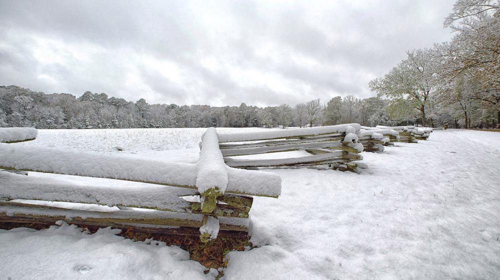 Snow covers a split-rail fence and trees near Mount Locust on the Natchez Trace in Jefferson County, Mississippi on Dec. 8, 2017.