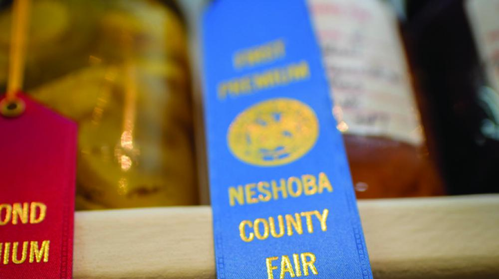 a red and blue ribbon from the Neshoba County Fair