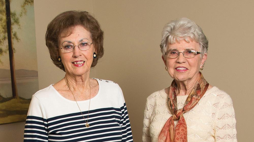 Two women philanthropists smiling.