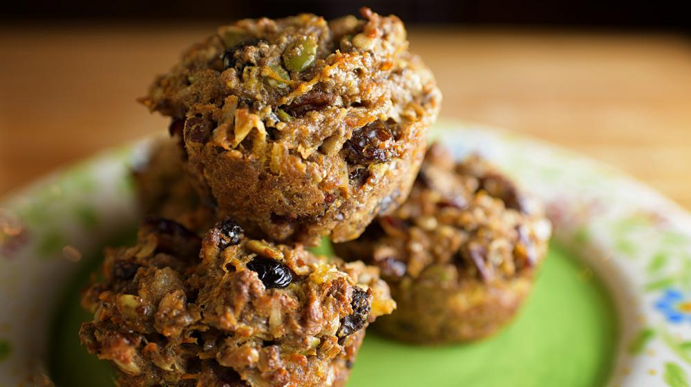 Five baked muffins loaded with fruit and nuts on a green floral plate. (Photo by MSU Extension Service/Kevin Hudson)