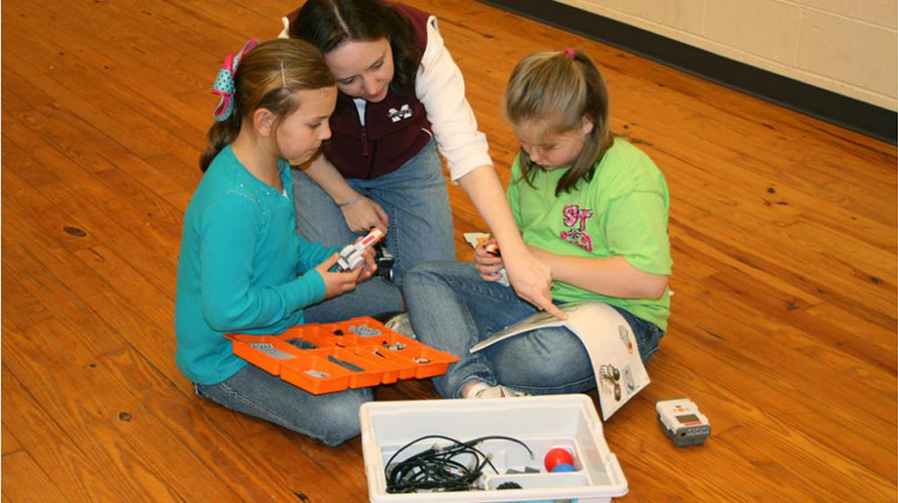 children working on their robotics project.