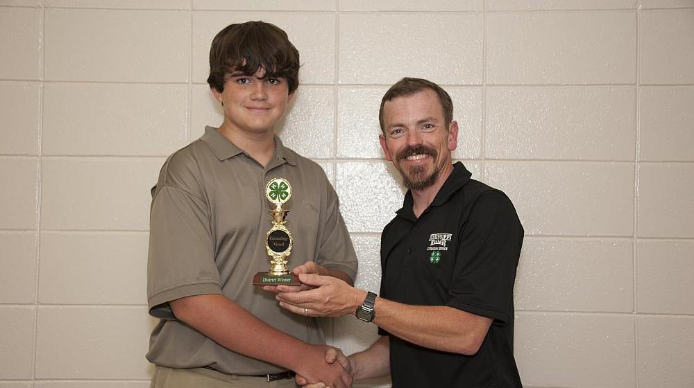 John Long gives award to 4-H member.