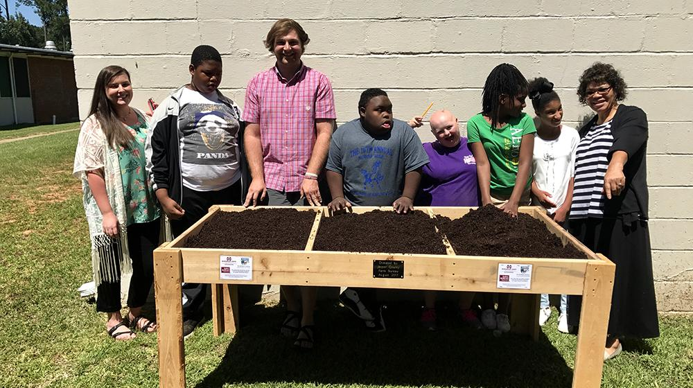 raised-bed gardens with group of 4-H students