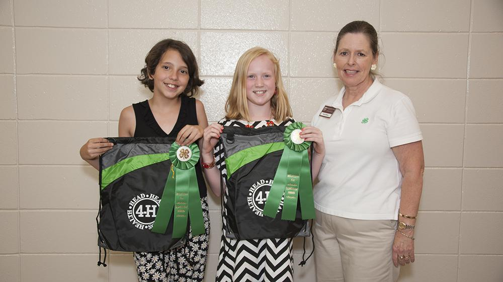 two youth 4-H winners with Dr. Rae Oldhham
