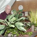 Joe Gordy visits the Mississippi State University campus frequently and has remained involved with his alma mater by serving on the MSU Foundation's board of directors. Here, the internationally renowned floral designer works with plants at MSU's Hunter Henry Center. (Photo by MSU Ag Communications/Kat Lawrence)