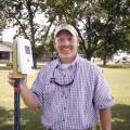 Jason Krutz, irrigation specialist with Mississippi State University's Delta Research and Extension Center, says he believes that soil moisture sensors can save farmers money, conserve water and extend the life of irrigation pumps. Krutz is holding one of the sensors during the Corn and Soybean Field Day in Stoneville, Miss., on July 18, 2013. (Photo by MSU Ag Communications/Linda Breazeale)