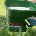 A person using a green manual fertilizer.