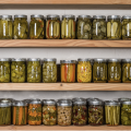 Canned fruits and vegetables on a shelf.