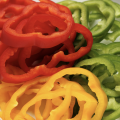 Sliced red, yellow and green bell peppers