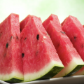 Close up of triangular watermelon slices on a plate.