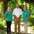 Brett Rushing, an assistant Extension and research professor at the Mississippi State University Coastal Plain Branch Experiment Station, works with Neeley Norman, left, and Sarah Kountouris on the Wildflower Trails of Mississippi, a program coordinated by Keep Mississippi Beautiful intended to turn Mississippi roadsides into pollinator habitats and tourist attractions. Norman is assistant director of Keep Mississippi Beautiful, and Kountouris is director. (Photo by MSU Extension Service/Kat Lawrence)