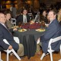 Six guests pause for a photo during a formal dinner.