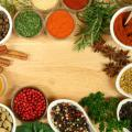 Closeup of herbs and spices on a cutting board.
