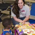 This is an image of Anna Hughes, a field technical assistant with the Early Years Network helped with post-tornado child care at a Red Cross Shelter in Louisville, MS in May, 2014.