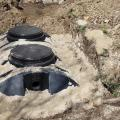 A newly installed septic tank system at a residential property for removal and purification of household grey wastewater and sewage.