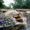 Blue Wave petunia, Aztec Silver Magic verbena and AngelMist Purple Stripe angelonia make for a great combination planting to complement this spectacular water feature.