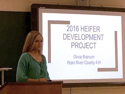 Girl presenting her 2016 heifer development project.