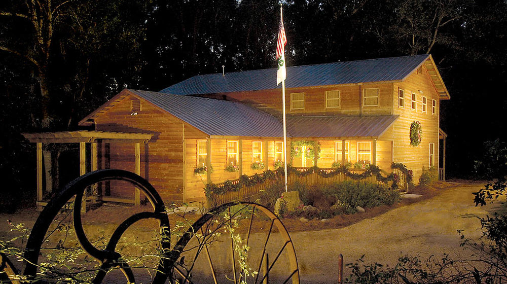 The Mississippi 4-H Museum at night illuminated with lights.