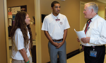 an image of two RMS students speaking with a physician.