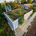 Green roof lawn accessed from the second floor of a modern house. Photo by Allison H. Anderson.