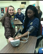 Students learning to take blood pressure readings.